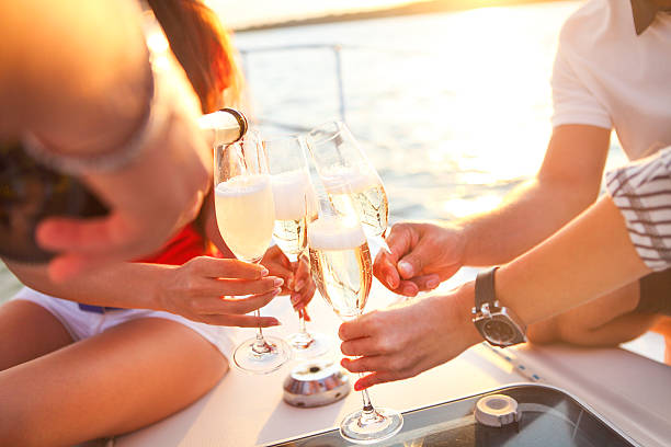 happy friends with glasses of champagne on yacht. vacation, trav - kreuzfahrt themenpartys stock-fotos und bilder