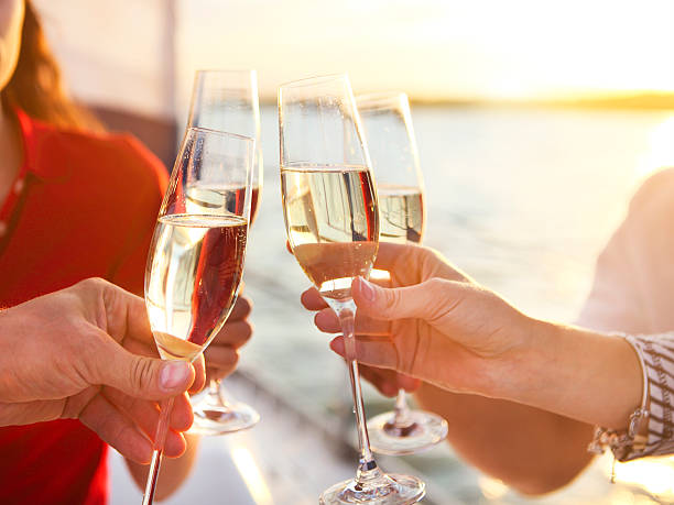 Happy friends with glasses of champagne on yacht. Vacation, trav - fotografia de stock