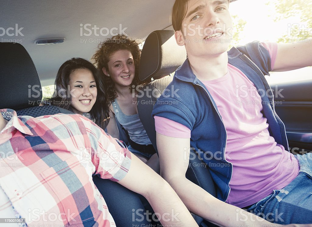 Happy friendship ready for a vacation inside car royalty-free stock photo