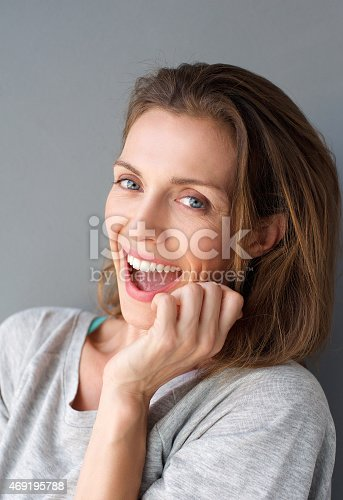 istock Happy fun mid adult woman laughing 469195788
