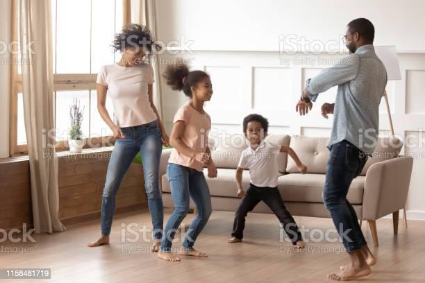 Happy funny active african family of four dancing at home picture id1158481719?b=1&k=6&m=1158481719&s=612x612&h=vw3iutz5me5i8p64gshacgahfrtwgvq9mgdv8kimkro=