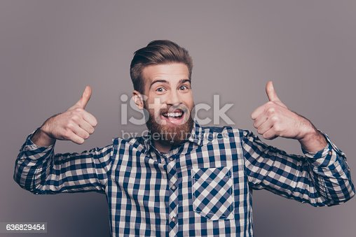 636829300 istock photo happy funny boyfriend show sight thumbs up and good luck 636829454