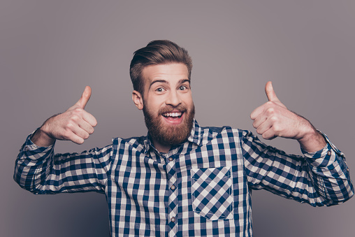 636829368 istock photo happy funny boyfriend show sight thumbs up and good luck 636829454