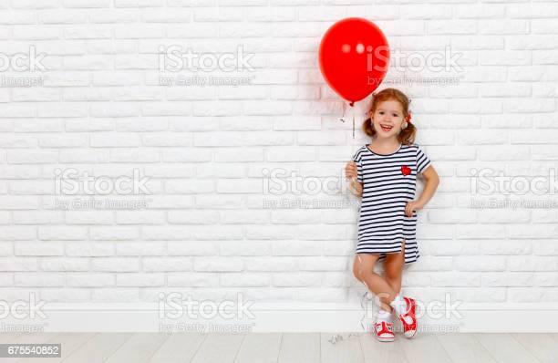 Happy funny child girl with red ball near an brick wall picture id675540852?b=1&k=6&m=675540852&s=612x612&h=xfu8z81kgsj6spoakfjzzjnjukgmw9ykrc jcl g2ly=