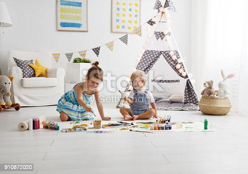 istock happy funny children paint with paint 910872020