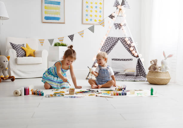 happy funny children paint with paint stock photo