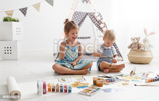 istock happy funny children paint with paint 958344616