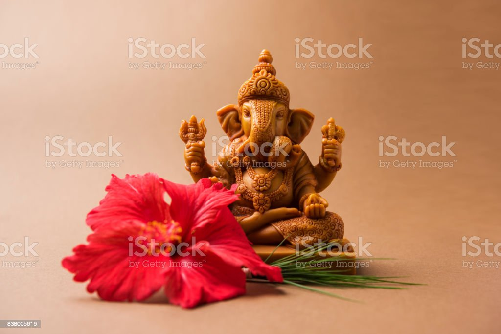 Happy Ganesh Chaturthi Greeting Card showing photograph of lord ganesha idol, pooja or puja thali, bundi laddu/modak, durva and hibiscus or jasvand flower stock photo