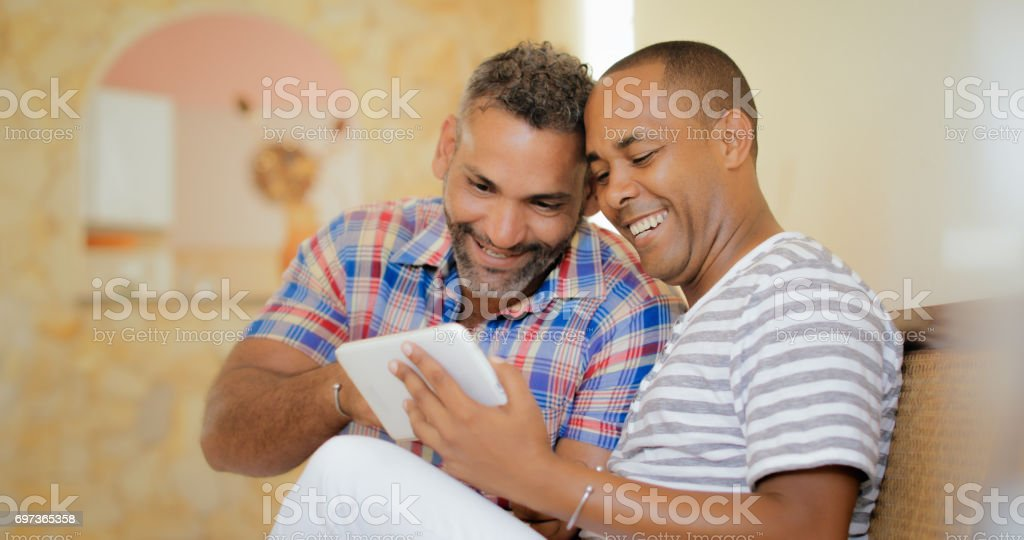 Happy Gay Couple Homosexual People Men Using Tablet stock photo