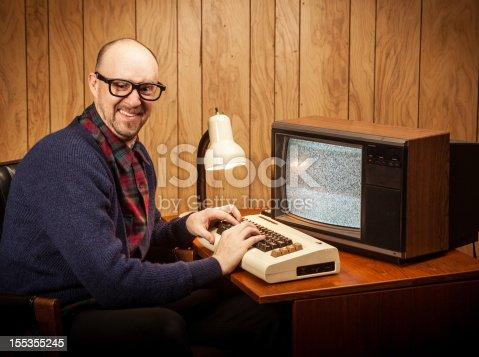 618210072 istock photo Happy Geeky Nerd Computer Science work man vintage style 155355245