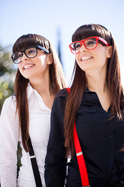 Happy Geeky Twins Smiling With Suspenders stock photo