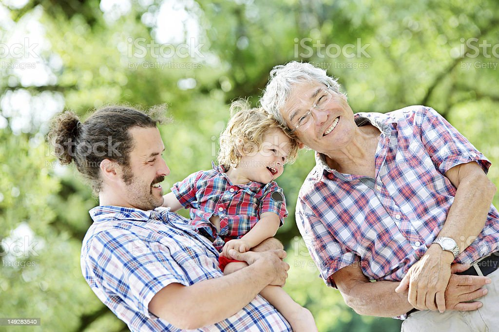 Happy Generations - Grandpa, Dad & Grandson royalty-free stock photo