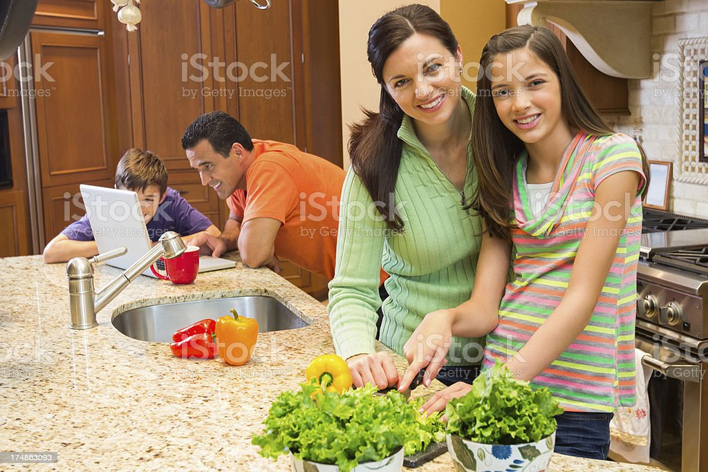 Happy Girl And Mother Preparing Food In Kitchen royalty-free stock photo