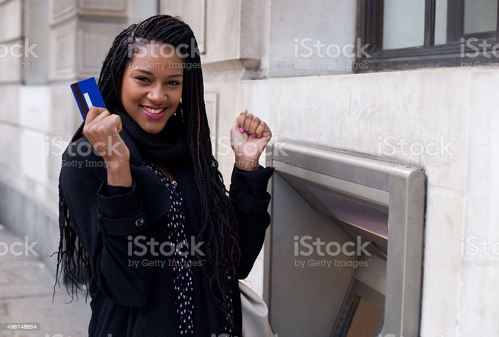 happy girl at ATM stock photo