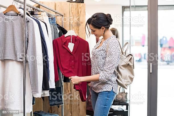 Happy girl at clothing store picture id637750968?b=1&k=6&m=637750968&s=612x612&h=xcy iqo 3eouw0ocm5bp5ekin28900tglf98bb3plsc=