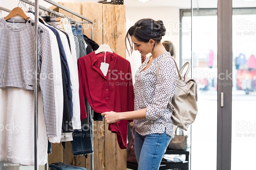 Happy girl at clothing store stock photo
