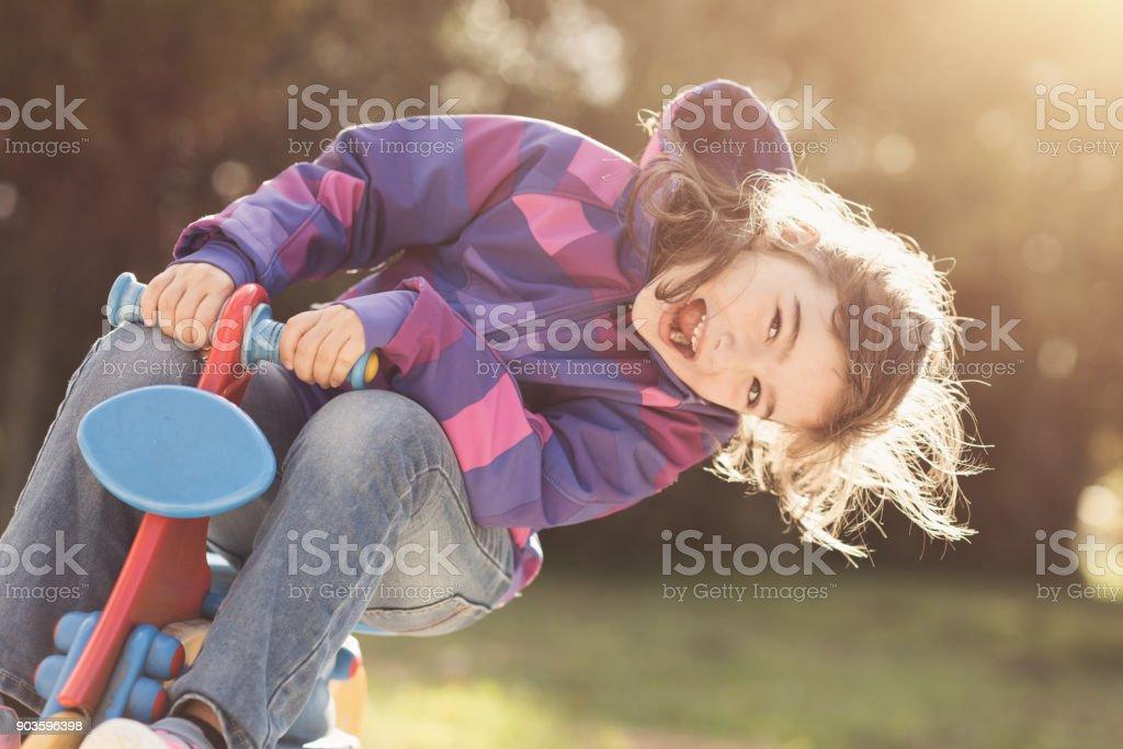 Happy girl at the playground stock photo