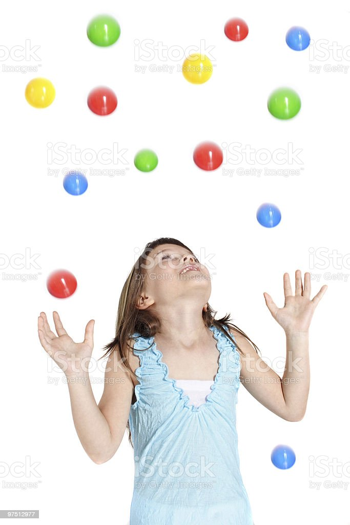 Happy girl catching colorful balls royalty-free stock photo