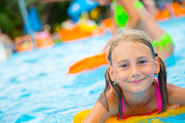 Laughing Girl Splashing With Water In Blue Swimming Pool Fotografier ... 253287e86f2dd