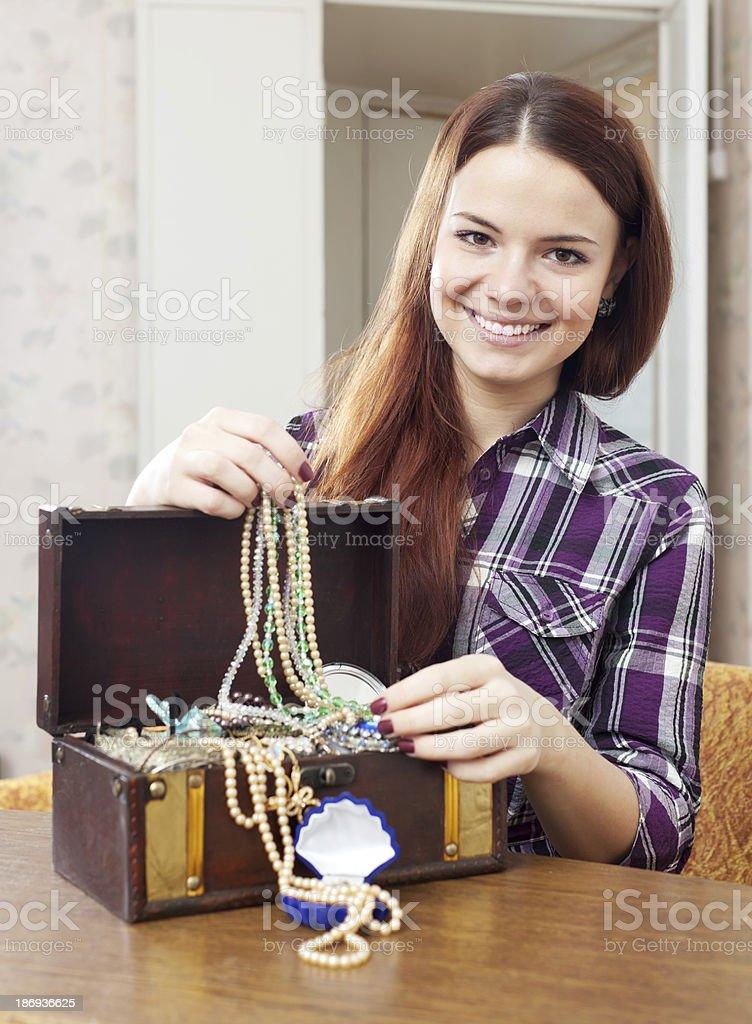 happy girl chooses jewelry royalty-free stock photo