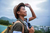 Portrait of young afro woman explorer