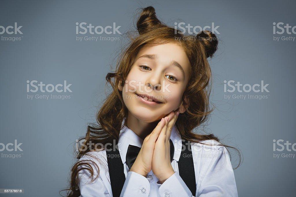Happy girl. Closeup Portrait of handsome teen pleading or beging stock photo