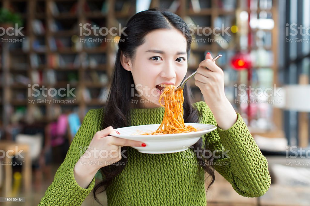 happy girl enjoy pasta stock photo