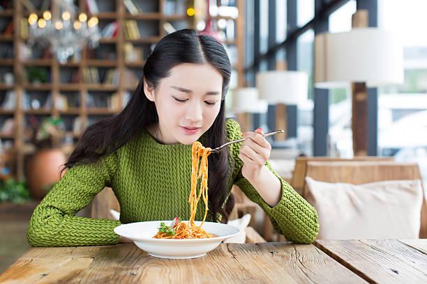 happy girl enjoy pasta stock photo