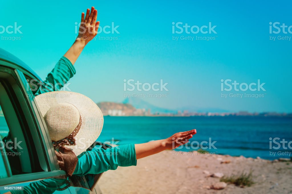 happy girl enjoy travel by car at beach stock photo