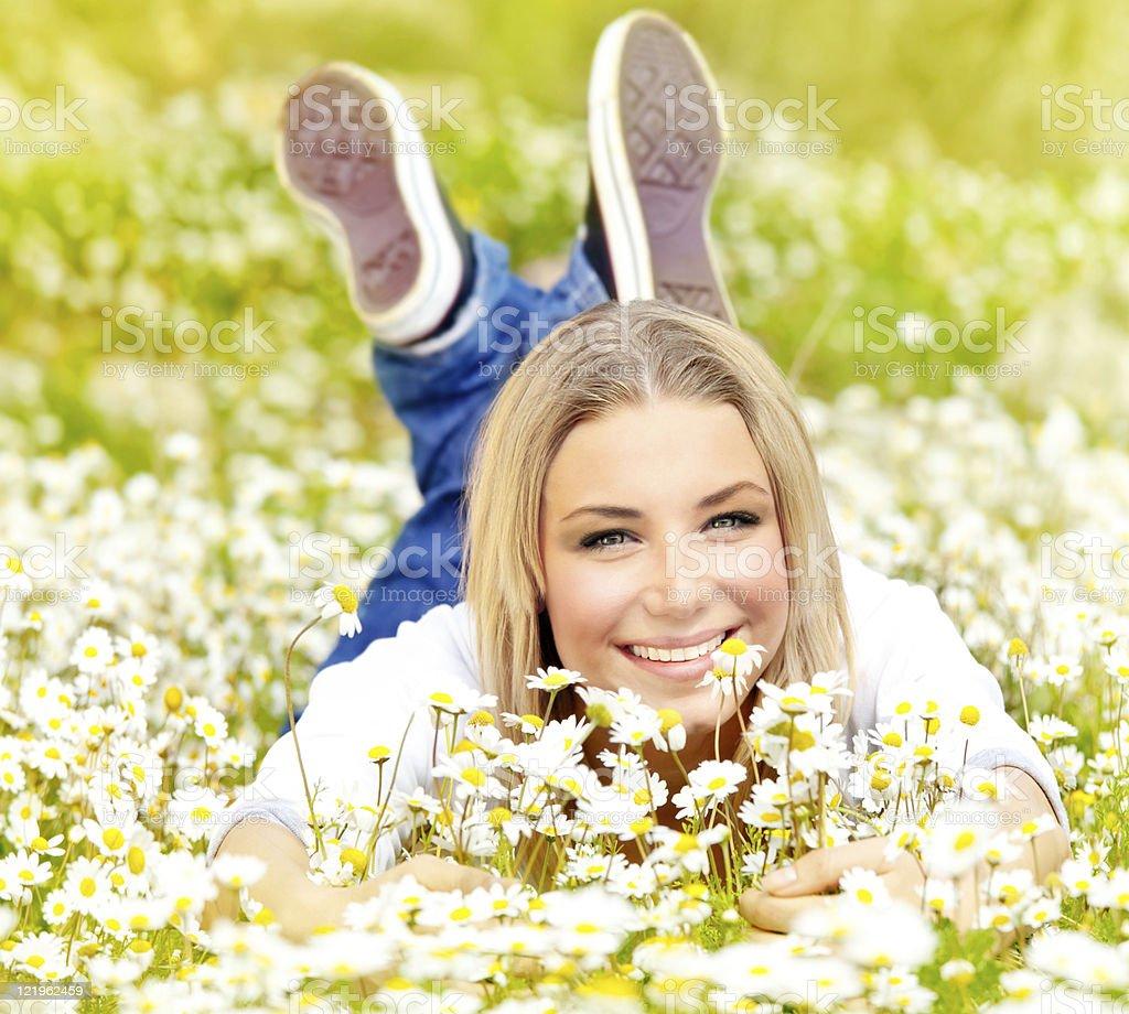 Happy girl enjoying daisy flower field royalty-free stock photo
