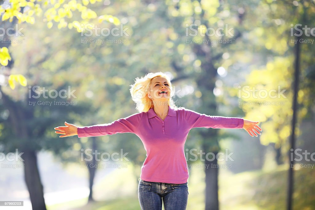 Happy girl funning in the autumn park. royalty-free stock photo