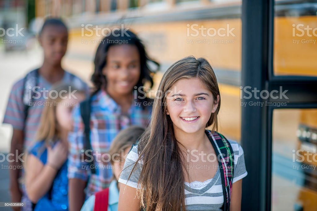 Happy Girl Getting on the Bus stock photo