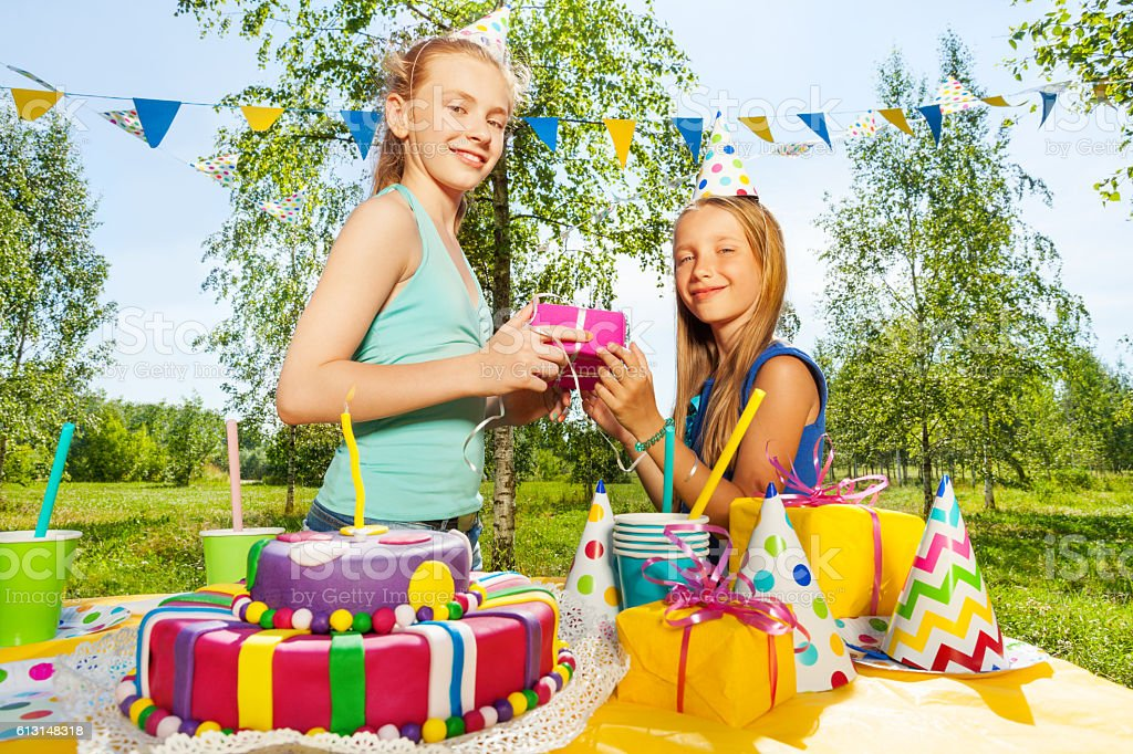 Happy girl giving birthday gift to her friend happy girl giving birthday gift to her friend negle Image collections