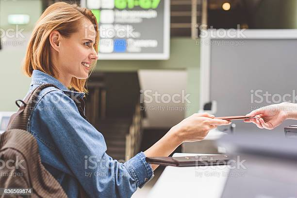 Happy girl handing over passport in airport picture id636569874?b=1&k=6&m=636569874&s=612x612&h=ikqzzalvctltdb6xs8ivtmlqapikdlepzeefaivr1b0=
