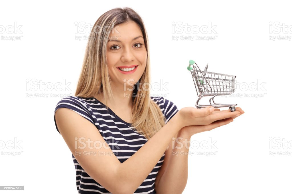Happy girl holding a small empty shopping cart foto stock royalty-free