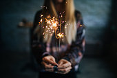 Happy girl holding burning sparklers