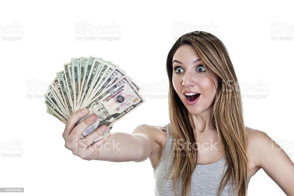 Happy girl holding cash royalty-free stock photo