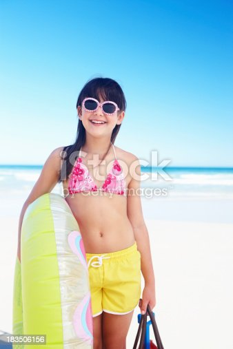 istock Happy girl holding float while on the beach 183506156