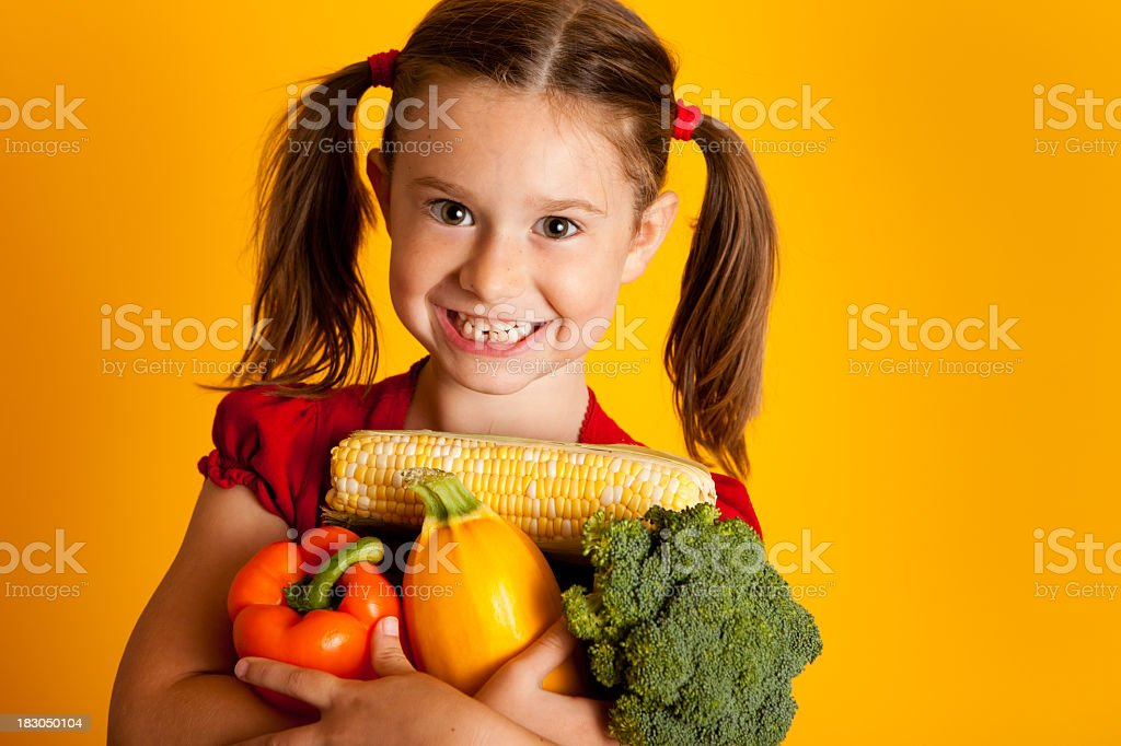 Happy Girl Holding Vegetables, Bell Peppers, Broccoli, Squash, Corn royalty-free stock photo
