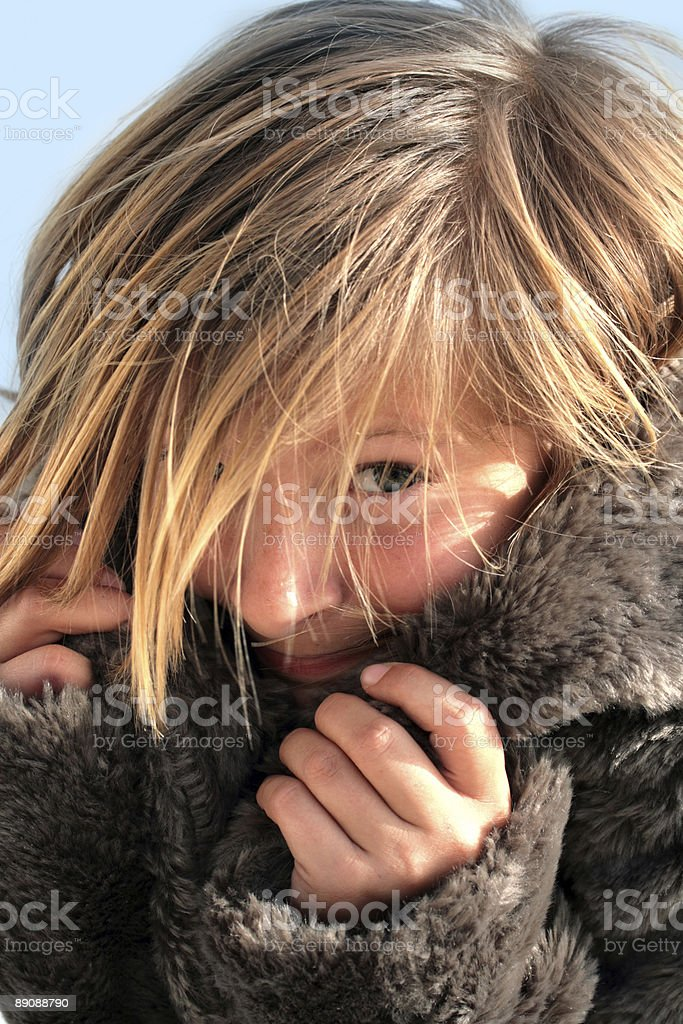 Happy girl in a fur coat stock photo