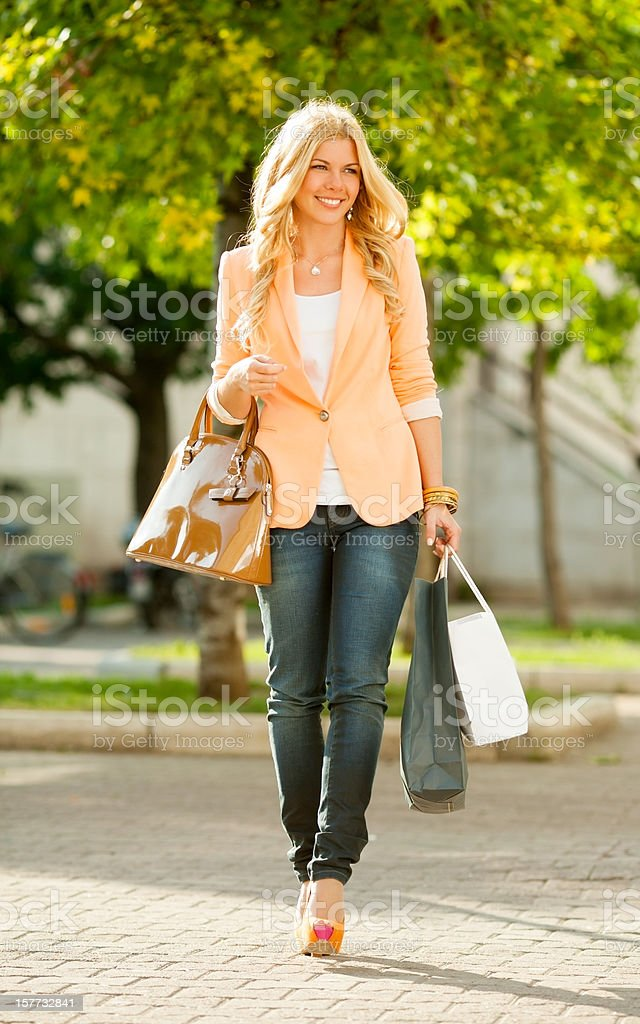 Happy girl in a shopping royalty-free stock photo