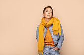 istock Happy girl in autumn yellow scarf. 1179962771