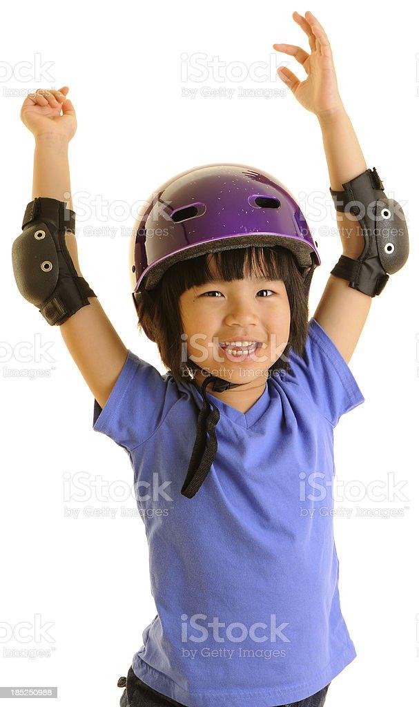 Happy Girl in Biking/Skateboarding Helmet Celebrating stock photo