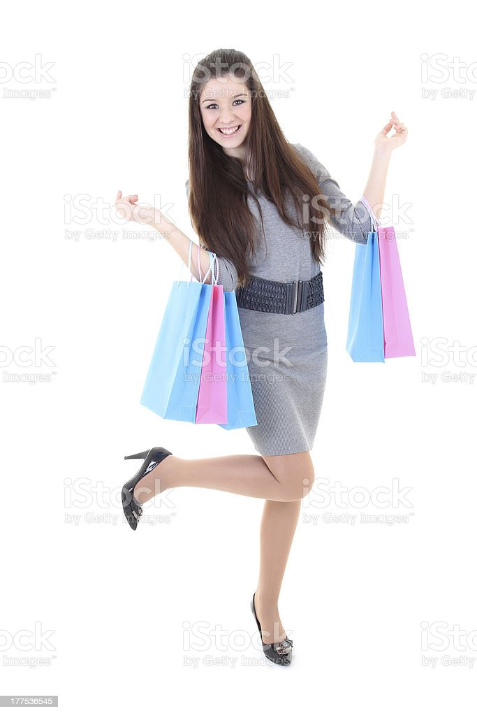 Happy girl in dress with shopping bags royalty-free stock photo
