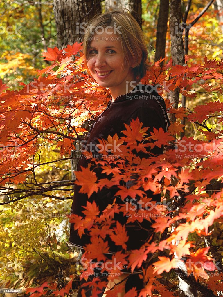 happy girl in fall maple forest royalty-free stock photo