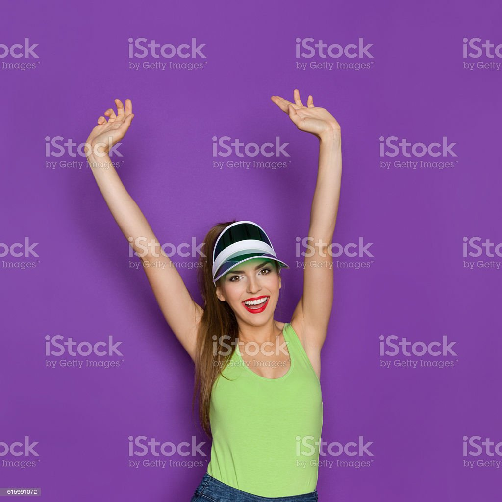Happy Girl In Lime Green Shirt Cheering stock photo
