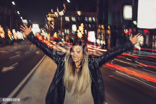istock Happy girl in middle of traffic 626854316