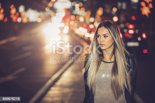 istock Happy girl in middle of traffic 635676216