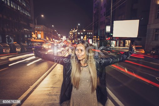 istock Happy girl in middle of traffic 635676236
