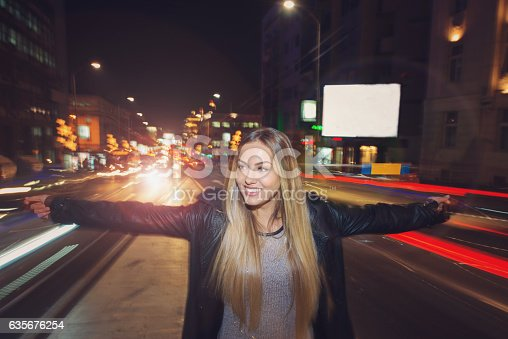 istock Happy girl in middle of traffic 635676254